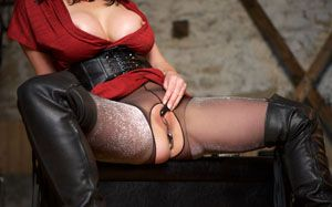 brunette in leather boots caresses pussy
